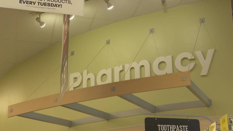 A pharmacy sign is pictured inside Hy-Vee Tuesday, Aug. 24, 2021.