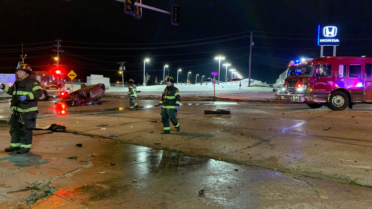 Emergency crews on the scene of an overturned car in Davenport Friday night.