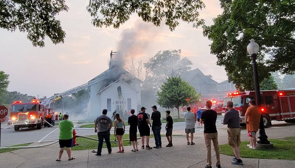 Fire crews in Geneseo battle a house fire Wednesday, July 28 in extreme heat
