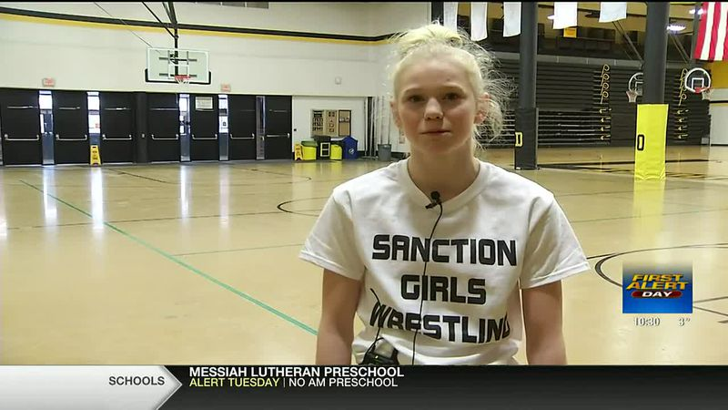 Ella Schmit and her teammates are promoting sanctioning girls wrestling by wearing matching...