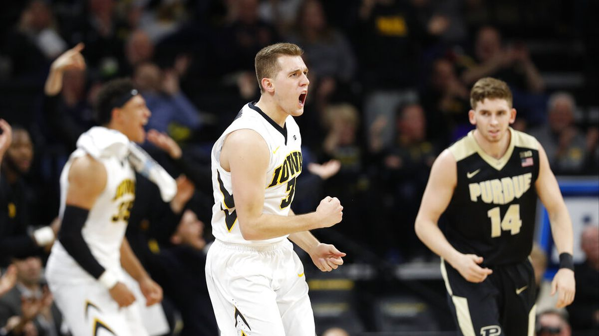 Iowa guard Jordan Bohannon (3) celebrates after making a 3-point basket during the second half...