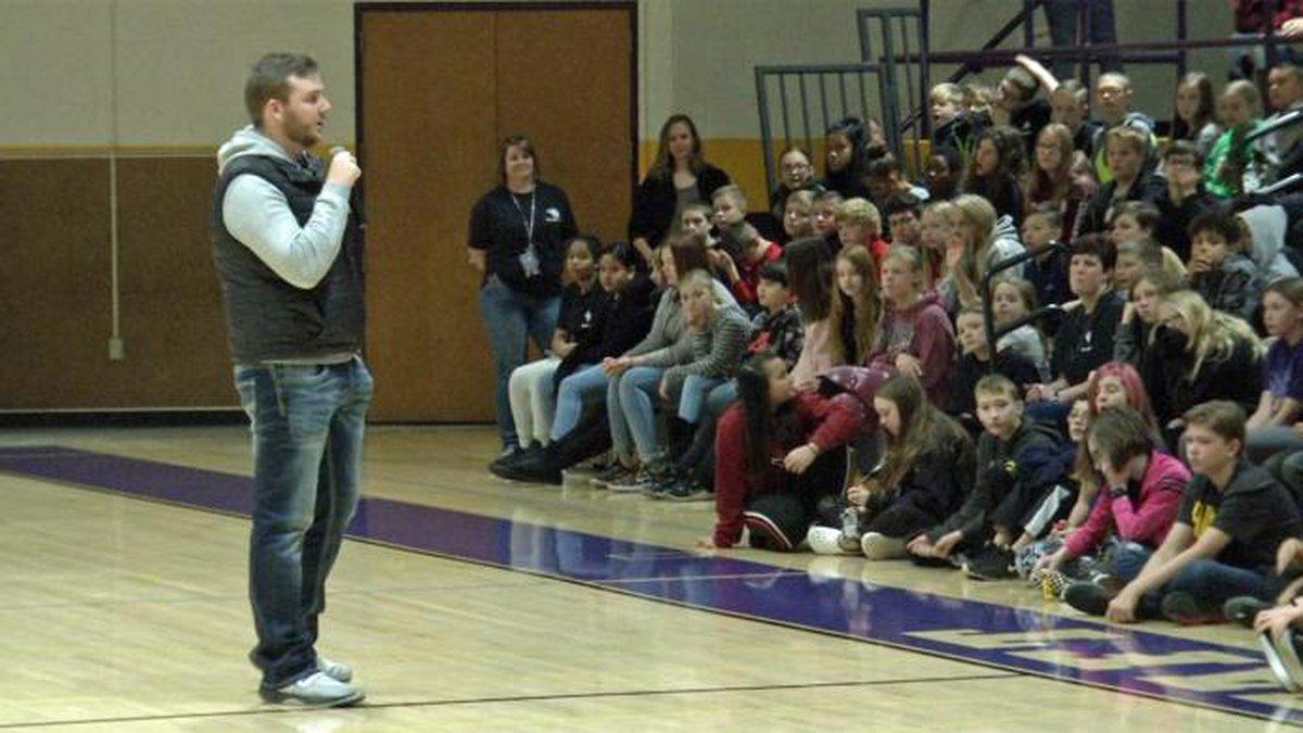 Carson King speaks to children at Taft Middle School in Cedar Rapids, Iowa on Monday, Nov. 18,...