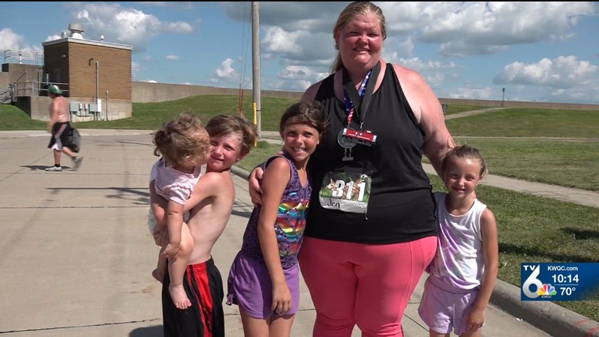 QC Woman beats world record for heaviest female to complete a marathon