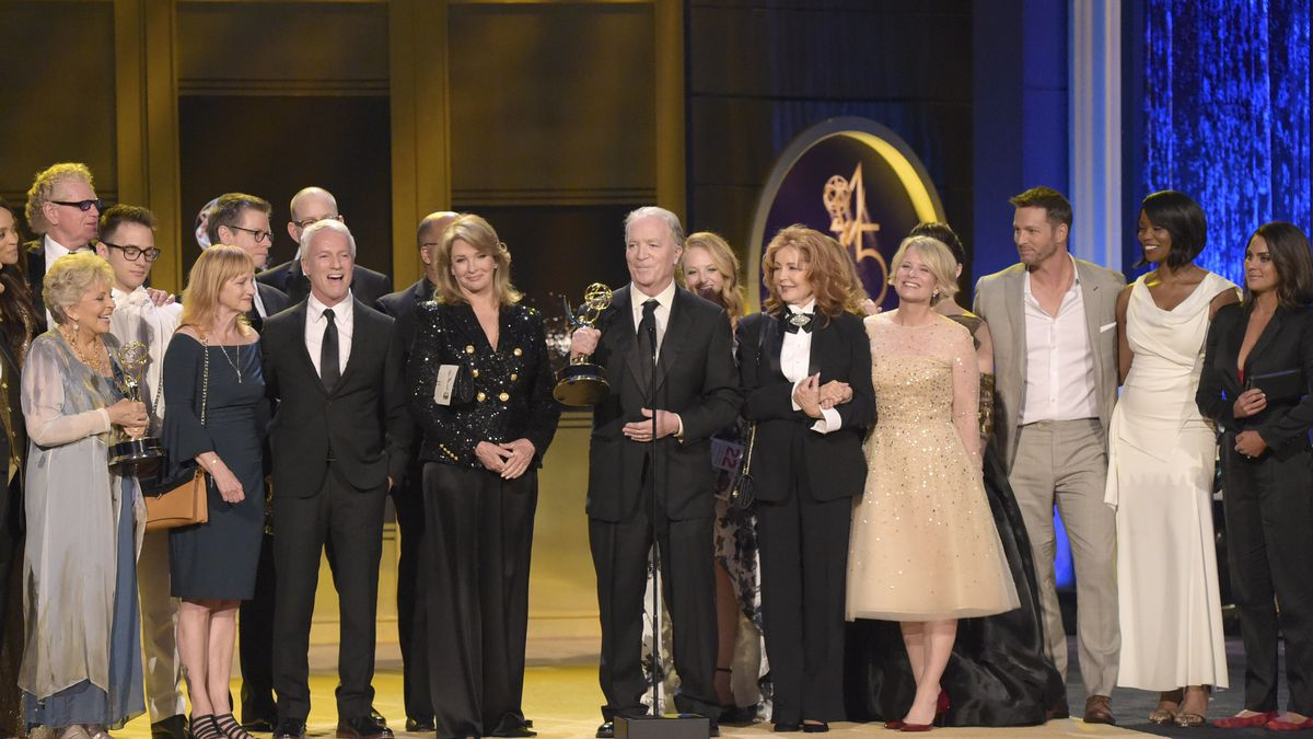 """FILE - This April 29, 2018 file photo shows Ken Corday, center, and the cast and crew of """"Days..."""