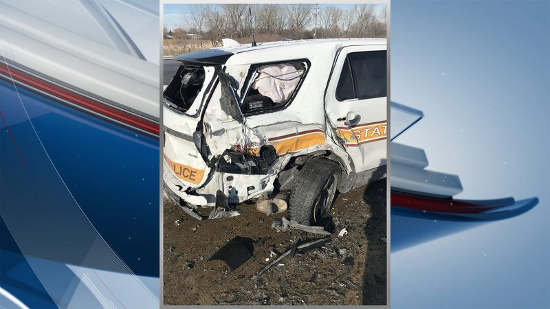 A driver has been charged after police say he crashed into an Illinois State trooper's vehicle...