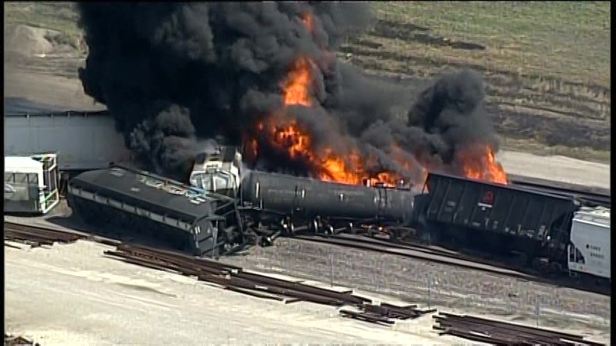 A freight train bearing a flammable liquid used in solvents derailed in an Illinois suburb of St. Louis Tuesday, causing a fire that sent thick, black smoke into the air. (Source: KTVI/CNN)