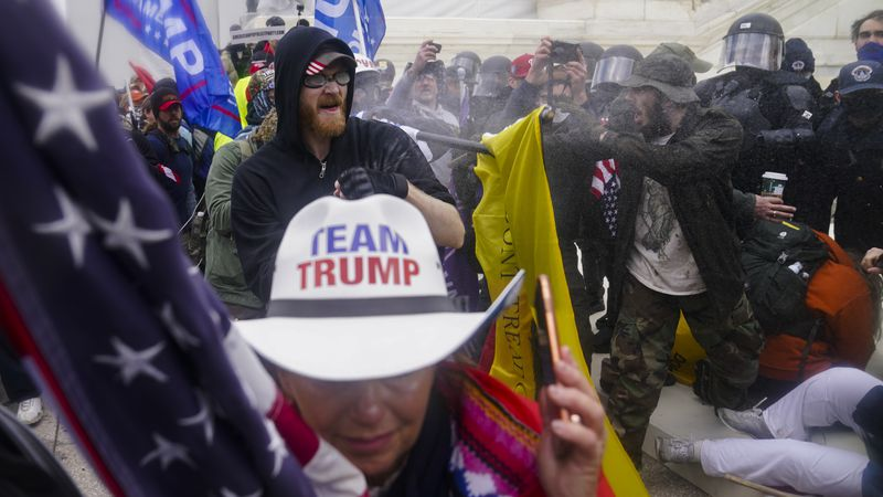 FILE - In this Jan. 6, 2021, file photo rioters loyal to President Donald Trump try to break...