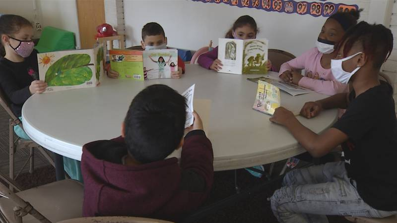 Children read at the YWCA of the Quad Cities in Rock Island, Ill.