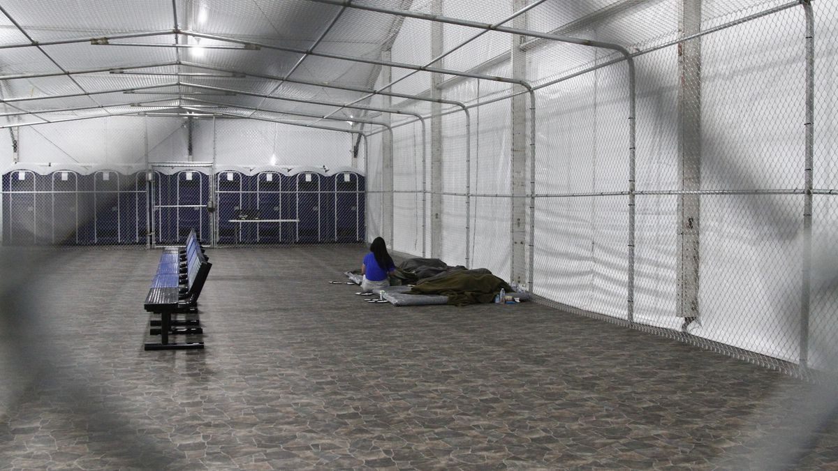 Migrants are detained in a tented, air-conditioned cage at a Border Patrol detention facility in Tornillo, Texas,  Thursday, Aug. 15, 2019. (AP Photo/Cedar Attanasio)
