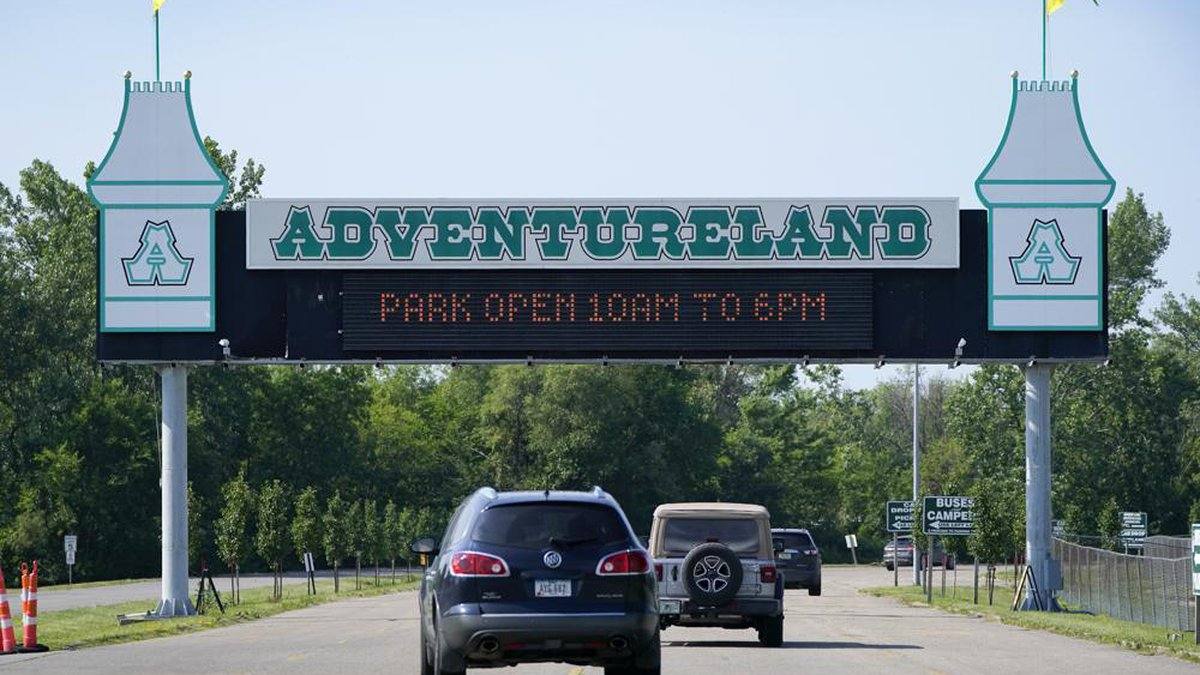 Visitors arrive at the Adventureland Park amusement park, Tuesday, July 6, 2021, in Altoona,...