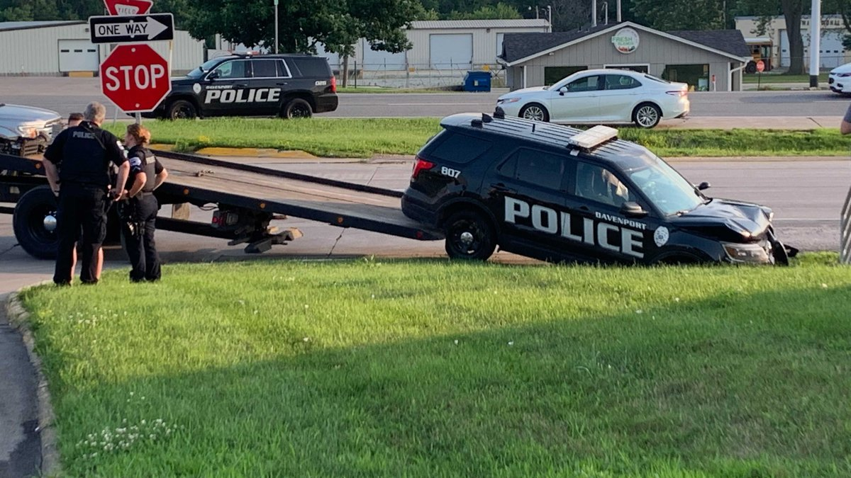 Davenport Police are investigating after a squad car was damaged in a crash Friday evening.