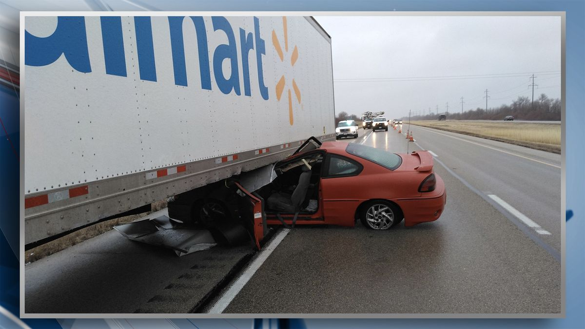 A 15-year-old driver and her passenger suffered minor injuries after the driver lost control and slide underneath a semi. (KWQC/Illinois State Police.)