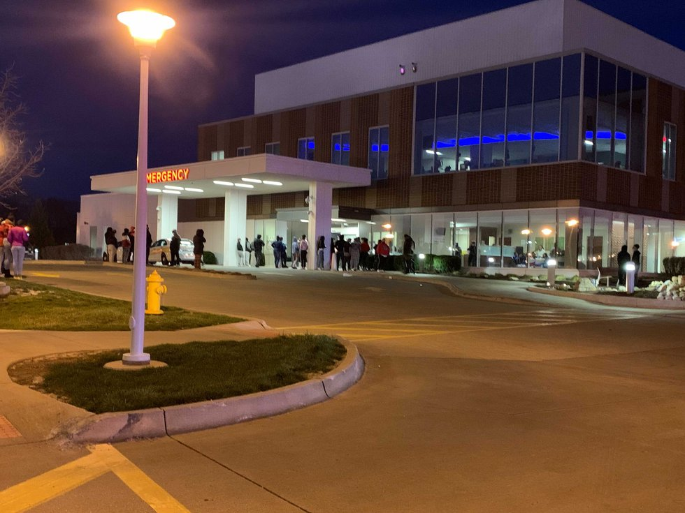 A group of people gathered at Unity Point Trinity after an officer-involved shooting.