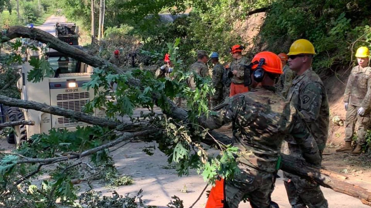 Members of the Iowa National Guard work on clearing debris from the Cedar Rapids area.