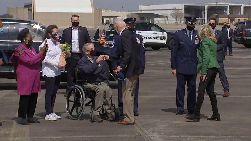 Texas Gov. Greg Abbot greets President Joe Biden on Friday after the president's arrival in...