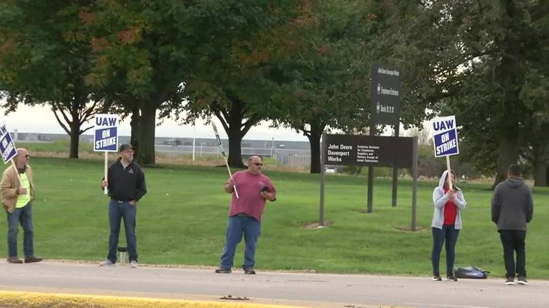 Deere & Co. employees with the United Automobile, Aerospace and Agricultural Workers picket on...