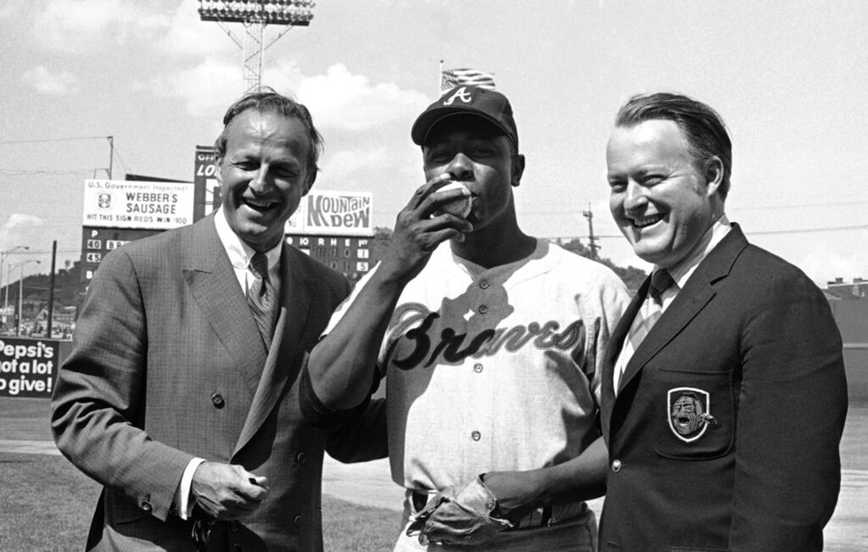 In this May 17, 1970, file photo Atlanta Braves' Hank Aaron, center, poses for photos after...
