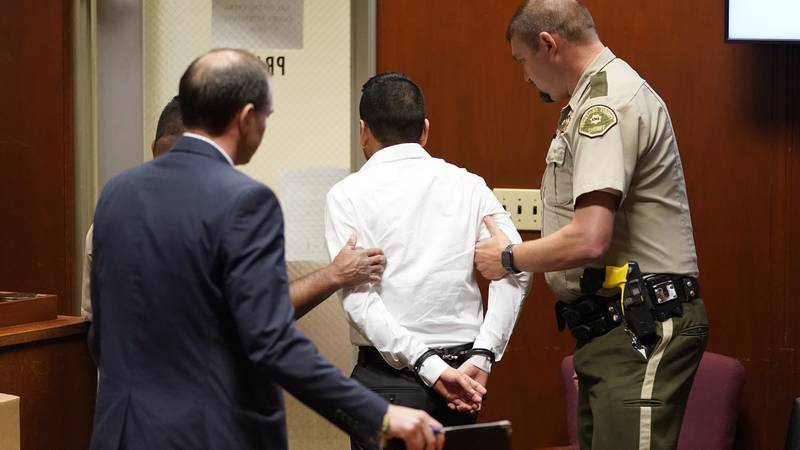 Cristhian Bahena Rivera, center, is taken out of the courtroom after the announcement of the...