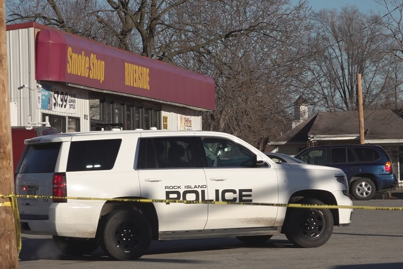 The parking lot of Riverside Liquor was blocked off Tuesday evening due a heavy police presence...
