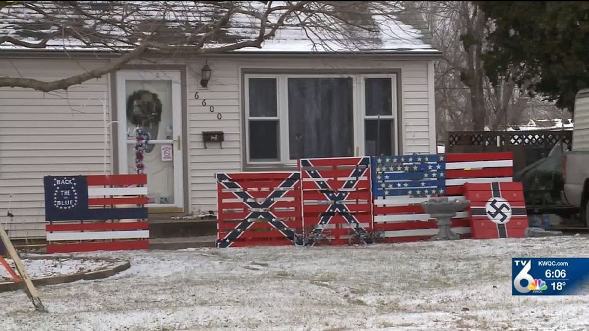 An Iowa man stands by his decision to post a large Nazi sign in his front yard, located across the street from an elementary school in Des Moines. (CNN)