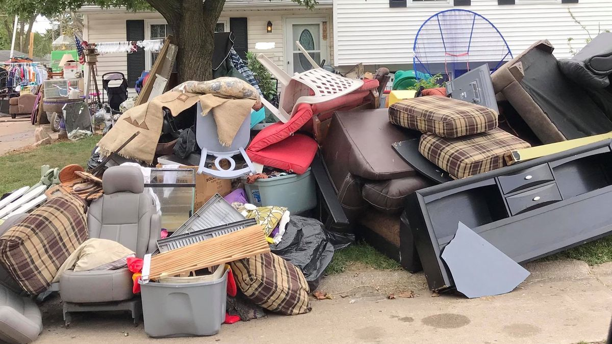 This rental house in the 2500 block of Crestview Drive in Bettendorf, Iowa, was found in violation of city code due to debris piles outside as of Sept. 6, 2019. (Jason Seeley)