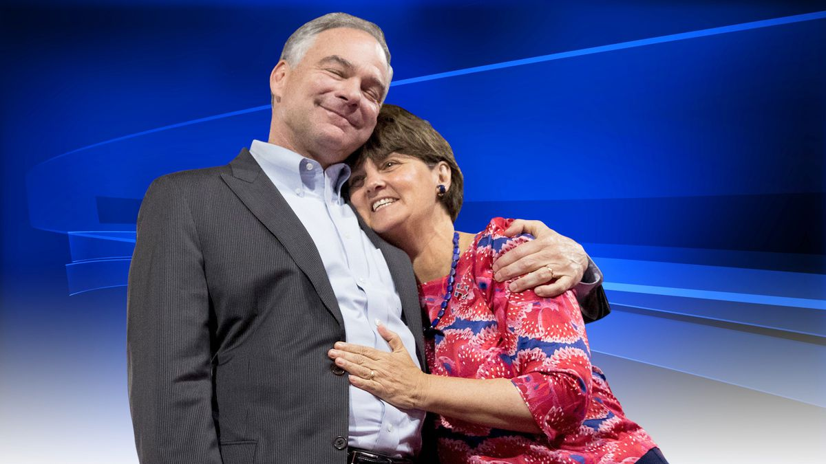 Virginia Senator Tim Kaine hugs his wife Anne Holton, during a Clinton rally, Miami, Florida. (Source: AP)