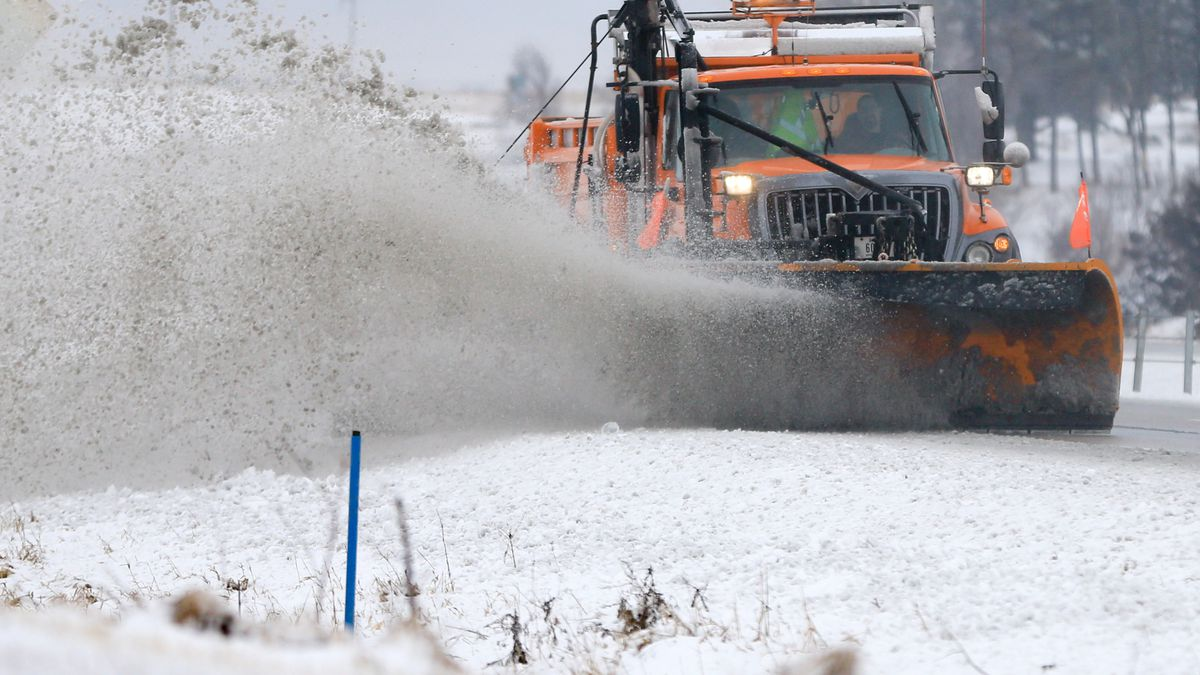 A snowplow clears snow off of Interstate 80 near  Earlham, Iowa, Tuesday, Feb. 2, 2016. A...