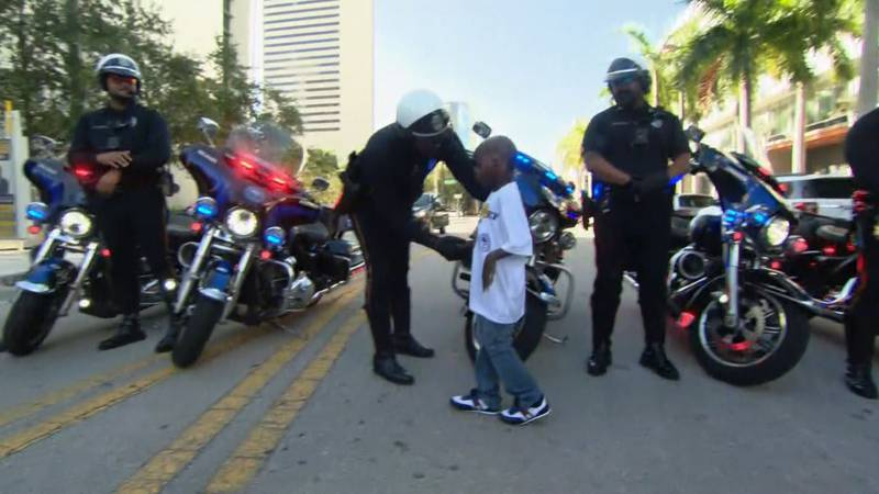 TJ Mack, a 5-year-old boy who was burned in a fire and lost his mother, is honored with being...