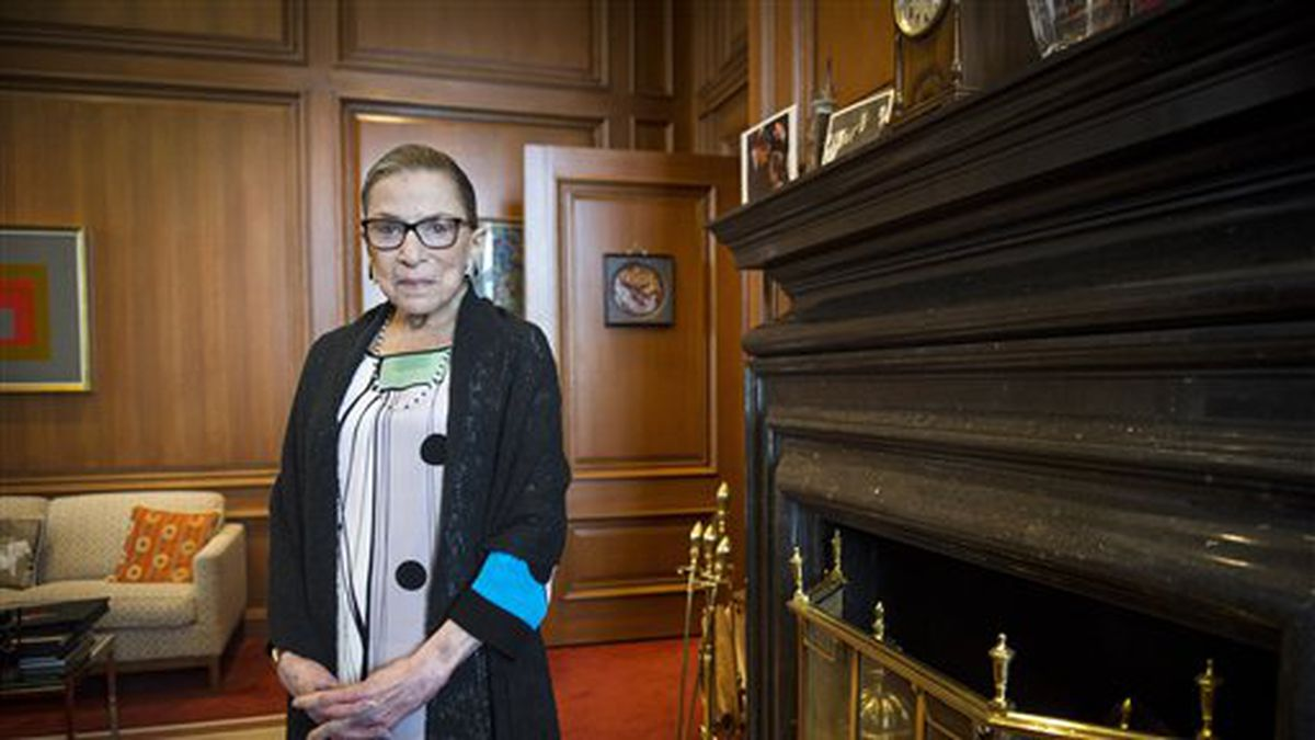 FILE - In this July 31, 2014 file photo, Associate Justice Ruth Bader Ginsburg is seen in her chambers in at the Supreme Court in Washington. The fastest and surest path to marriage for same-sex couples in some parts of the United States would be for the Supreme Court to surprise everyone and decline to get involved in the issue right now. A decision by the justices to reject calls from all quarters to take up same-sex marriage would allow gay and lesbian couples in Indiana, Oklahoma, Utah, Virginia and Wisconsin to begin getting married almost immediately. Rulings in their favor have been put on hold while the Supreme Court considers their cases. Ginsburg appeared to be addressing that concern when she said in July that the court would not duck the issue as it did for years with bans on interracial marriage. (AP Photo/Cliff Owen, File)