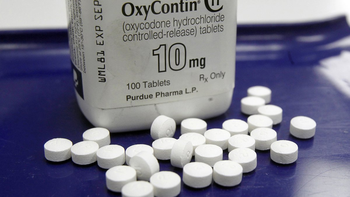 FILE - This Feb. 19, 2013, file photo shows OxyContin pills arranged for a photo at a pharmacy...