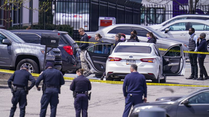 Law enforcement confer at the scene, Friday, April 16, 2021, in Indianapolis, where multiple...