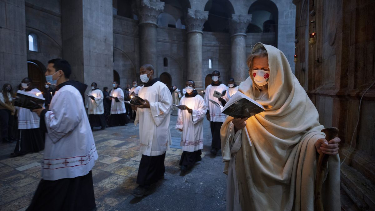 Priests circle the Edicule during Easter Sunday Mass led by the Latin Patriarch at the Church...