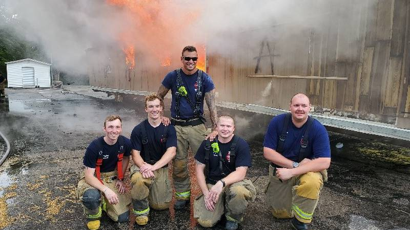 Fire Academy graduates (left to right) Spencer Ludman, Dan Deckert, Michael Fleming, and Joseph...