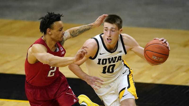 Iowa guard Joe Wieskamp (10) drives to the basket past Nebraska guard Trey McGowens, left,...