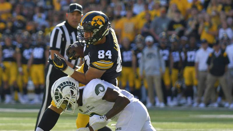 Colorado State defensive back Tywan Francis (8) tackles Iowa tight end Sam LaPorta (84) on a...
