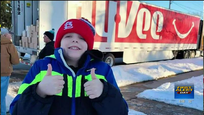 Muscatine boy receives donation for his food pantry