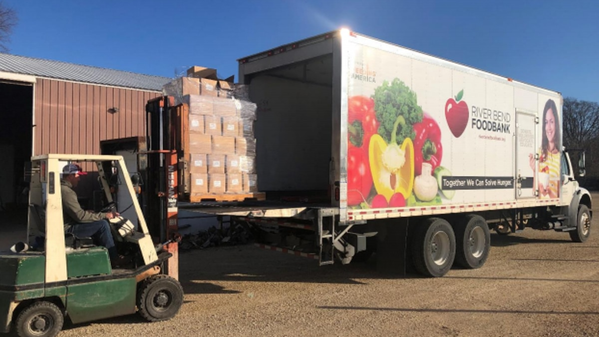 4,400 pounds of ground pork gets loaded onto a River Bend Foodbank truck for delivery and...