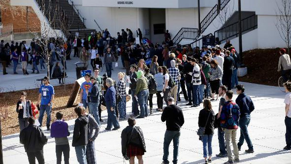 FILE - In this Feb. 20, 2016 file photo people line up to participate in the Democratic caucus...