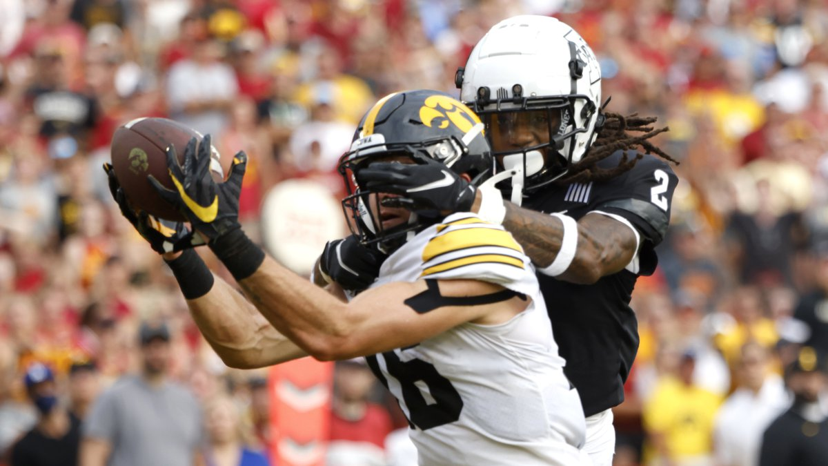 Iowa's Charlie Jones catches a touchdown pass as Iowa State's Datrone Young tries to defend in...