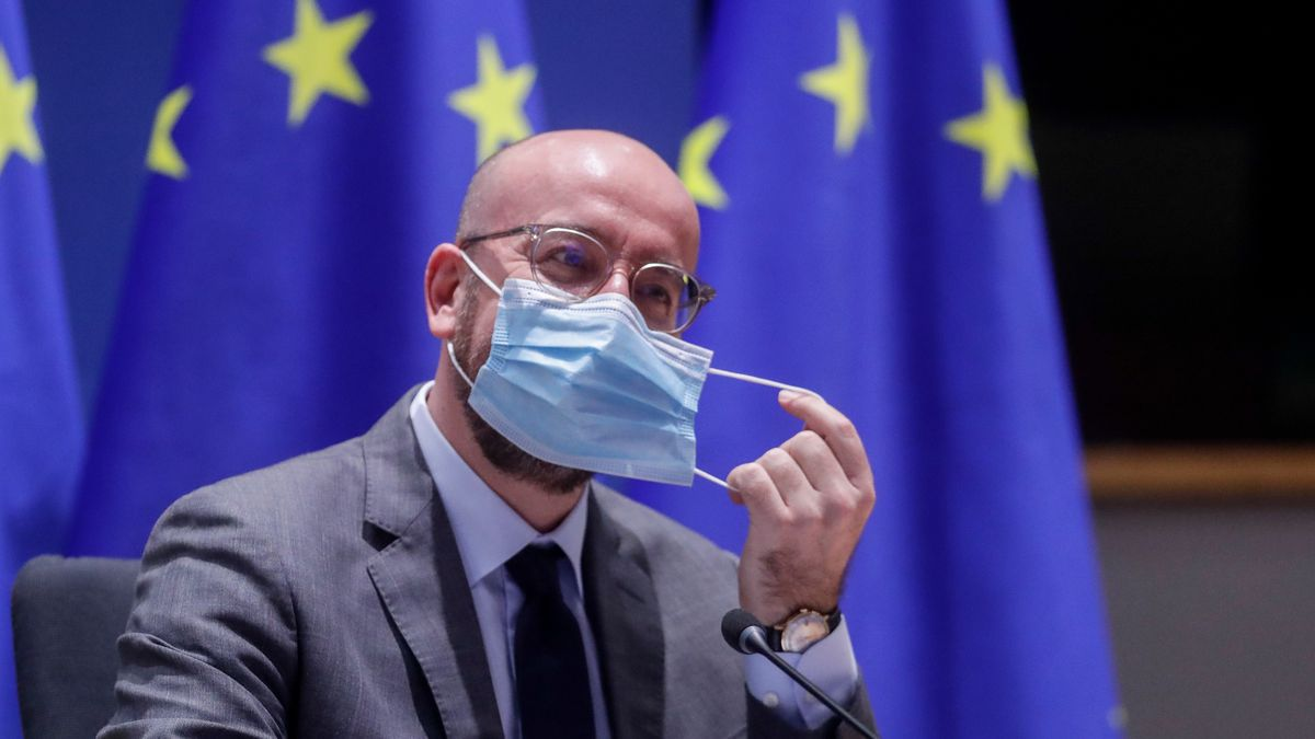 European Council President Charles Michel removes his face mask as he chairs a EU summit video...