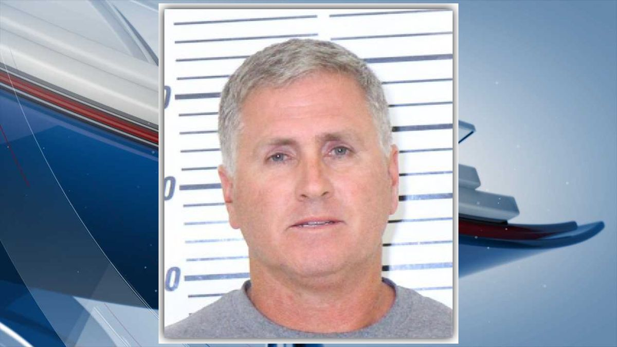 Jay Lee Fitzgerald, 57, is listed as a teacher on Bettendorf High School's website. (Scott County Jail)