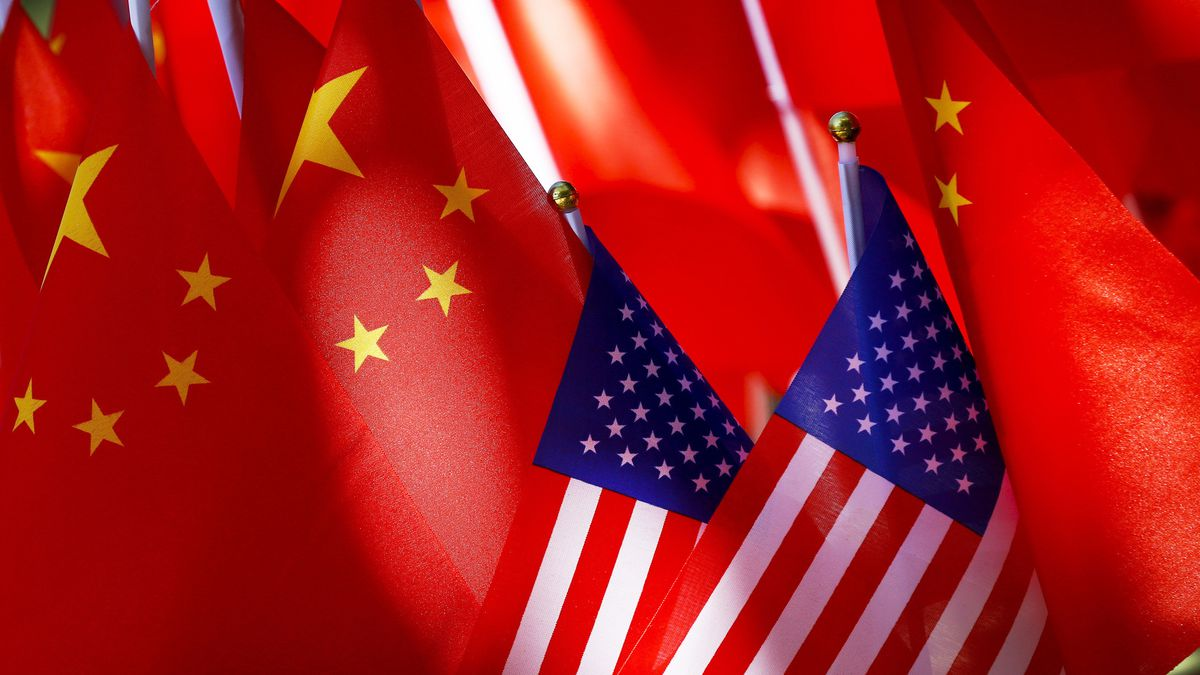 In this Sept. 16, 2018, file photo, American flags are displayed together with Chinese flags on...