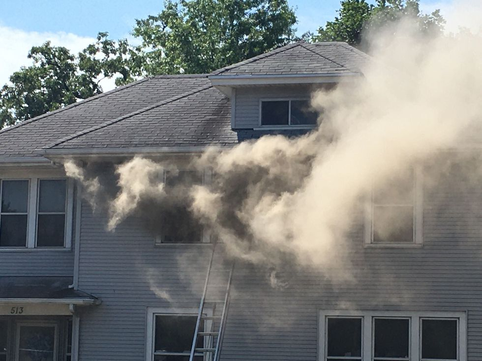 Fire crews and police are on scene of a house fire in the 500 block of East Locust Street in Davenport.